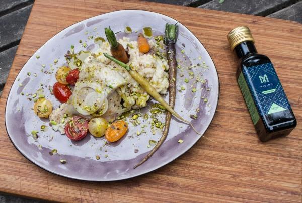Forel met amandelrisotto en pistacheolie